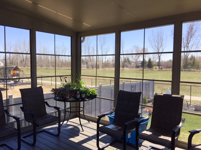 Regina window and exterior-sunroom build